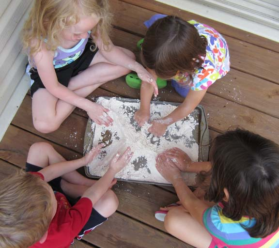 kids playing with cloud dough