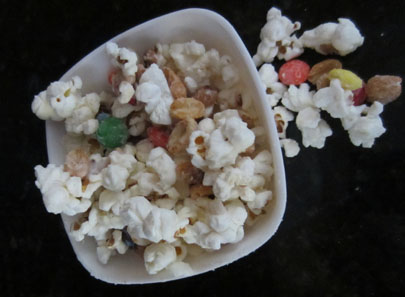 popcorn with peanuts, m&ms, and almond bark