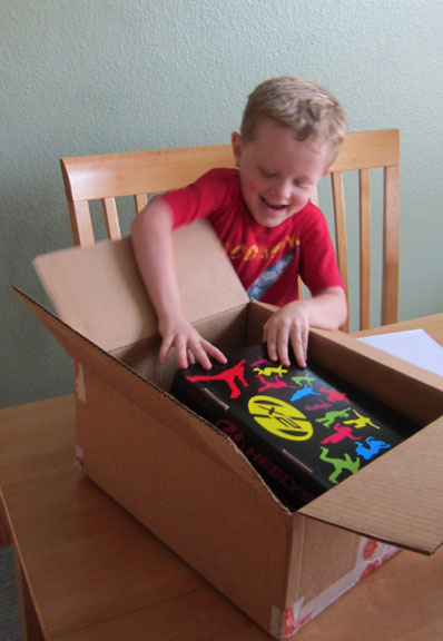 Kid opening new box of Heelys