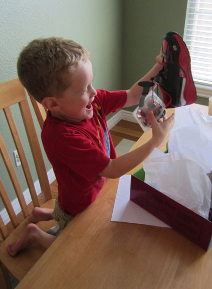 Kid looking at new Heely HX2 shoes