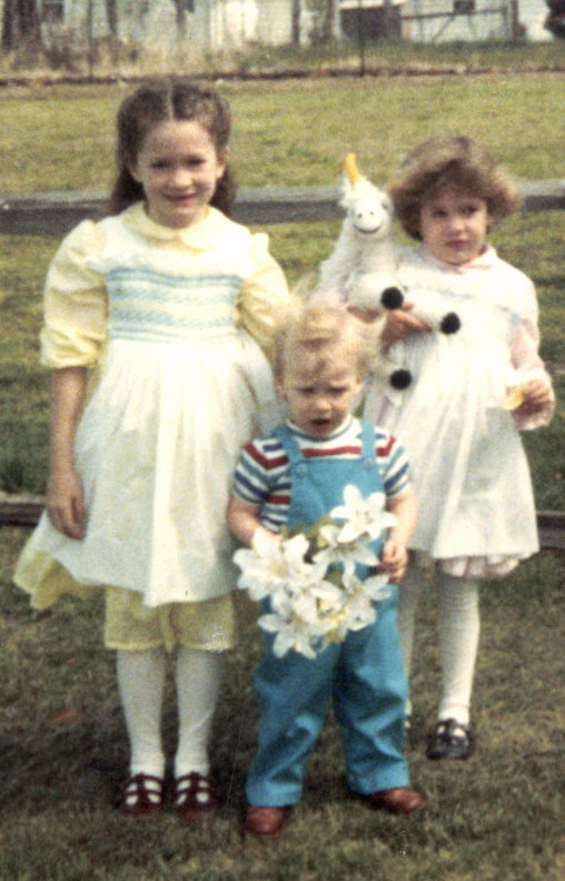 Me in the Pinafore with my siblings, circa 1985