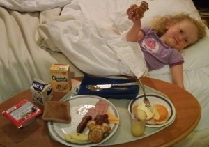 child eating breakfast in bed