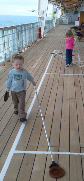 kids playing shuffleboard on a cruise